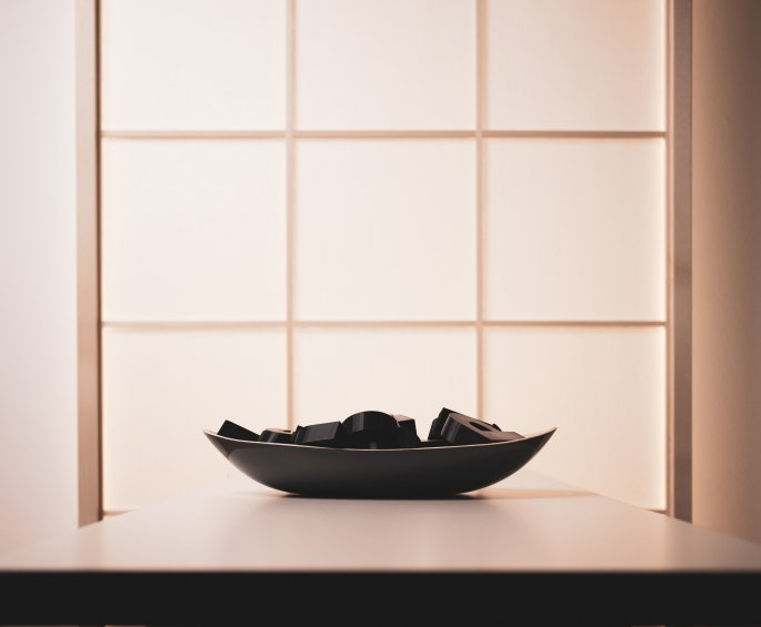 Filled Bowl On Table In Front Of Translucent Window