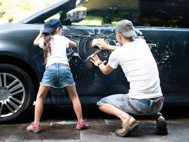 Father & Daughter Cleaning A Car